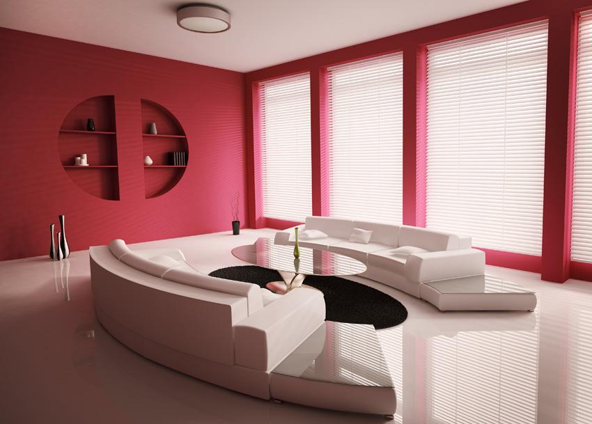 Pavimento lucido del soggiorno e pareti rosse. Un particolare contrasto esaltato dalla resina lucida e opaca