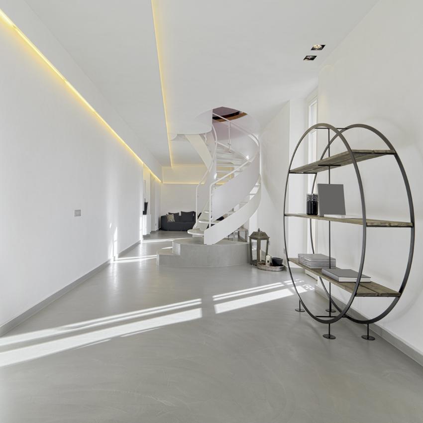 Resina sul pavimento di questa casa minimal realizzata dall'arch Bazzan