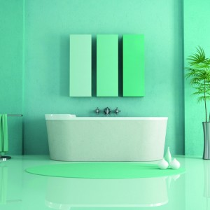 various shades of green for the walls and floor in resin of this modern bathroom