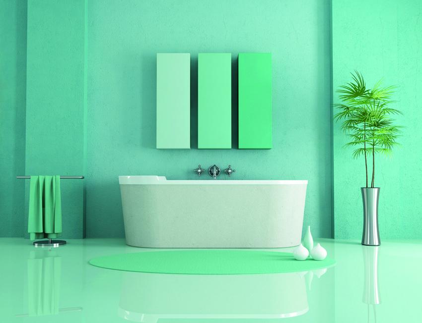 varie tonalità di verde per le pareti e il pavimento in resina di questo bagno moderno